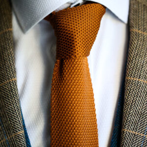 Rust knitted tie from Marc Darcy