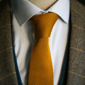 Gold knitted tie from Marc Darcy